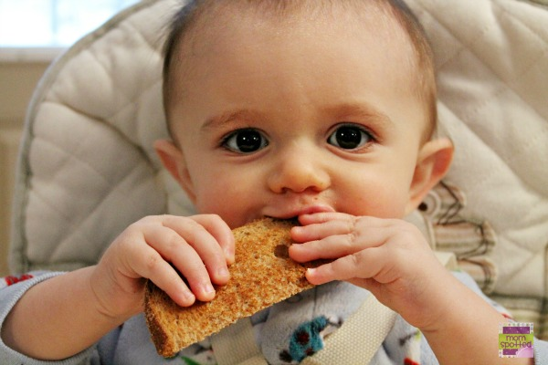 Sawyer James eating toast 10 months  #momspotted
