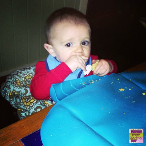 Sawyer in high chair cover and table placemat