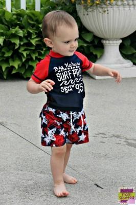 Sawyer swimming in OshKosh bathing suit momspotted toddler boy