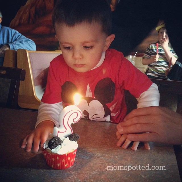 Mickey & Minnie Mouse Cupcakes {Sawyers 2nd Birthday Party} #momspotted Blowing out candle
