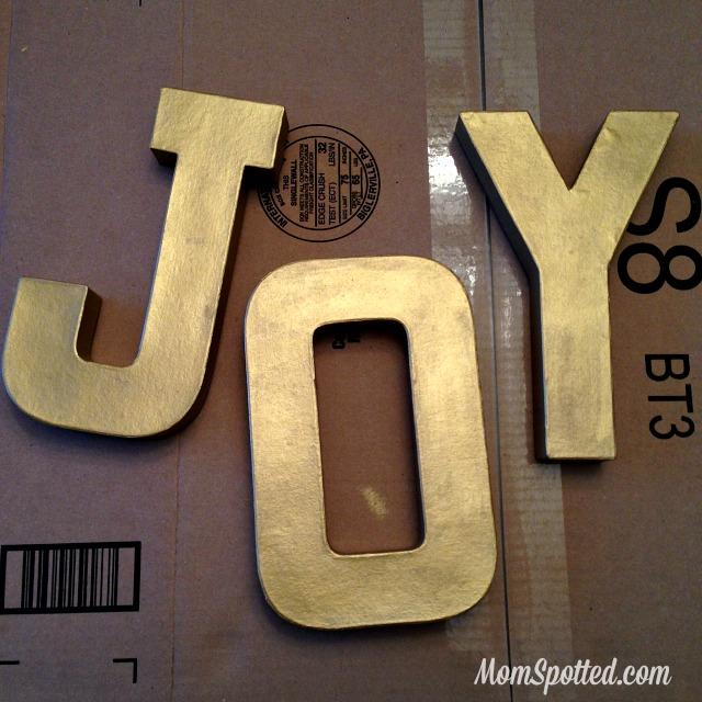 make your own gold glittery christmas letter decoration tutorial found on momspottedcom glitter