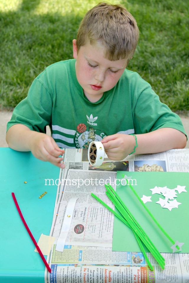 Gavin making the Mayflower - A Massachusetts State Flower Craft