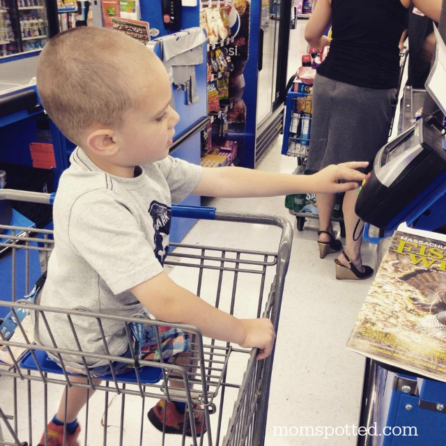 Sawyer paying bill at Walmart
