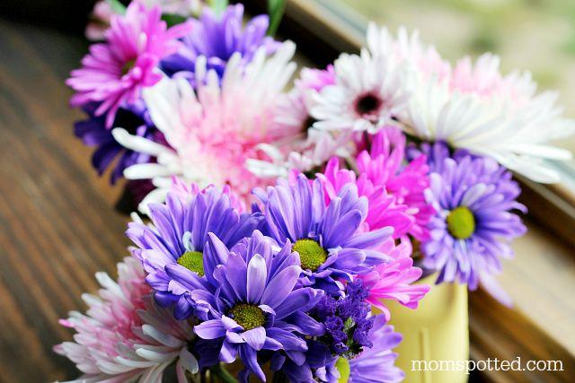 pretty flowers in mason jar vases