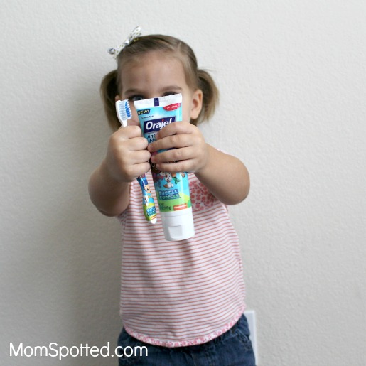 how to teach toddler to spit out toothpaste