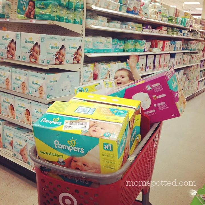 Sawyer James shopping for Pampers Dipaers