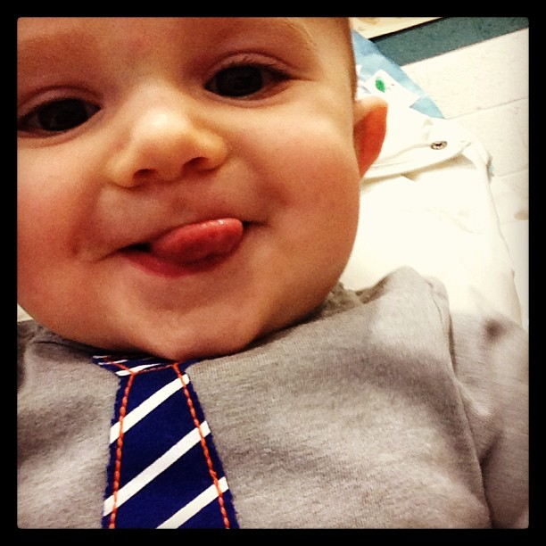 cute adorable baby sawyer #momspotted sticking out tongue in tie shirt