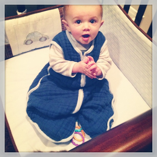 Sawyer 1st time sitting up in crib #momspotted
