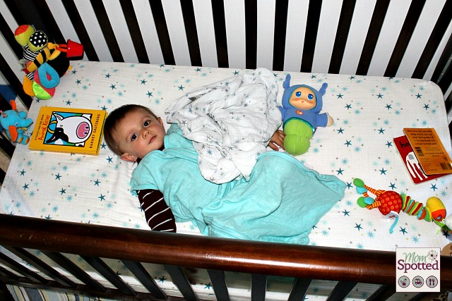 Sawyer in his crib with aden + anais sleeping bag & sheet