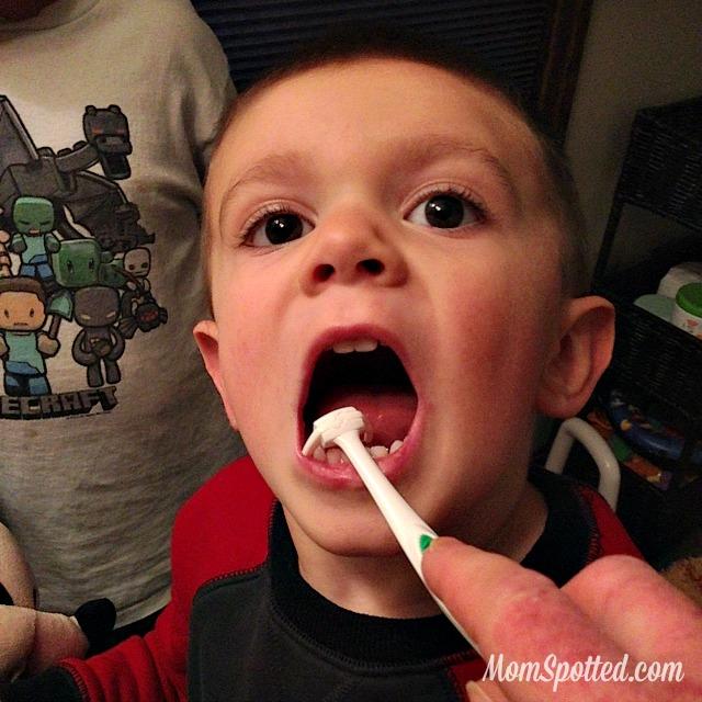 Sawyer James flossing his teeth