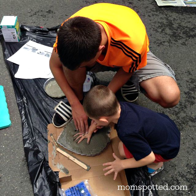 Brothers making handprints in stepping stones for our garden