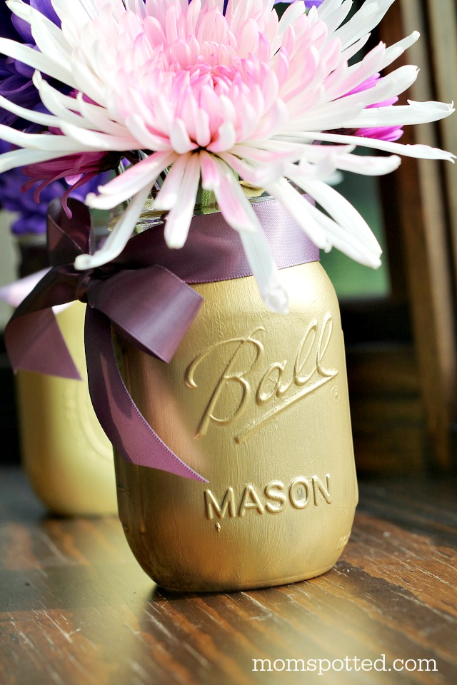 DIY Painted Mason Jar Flower Vases! These are great for wedding, baby showers, and even as home decor! Find directions on momspotted