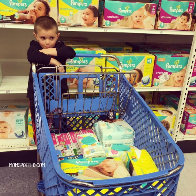 Sawyer shopping for Pampers Diapers at Babies R Us